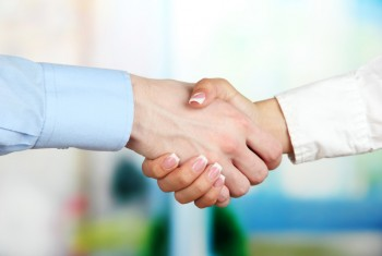 bigstock-Business-handshake-on-bright-b-47257330